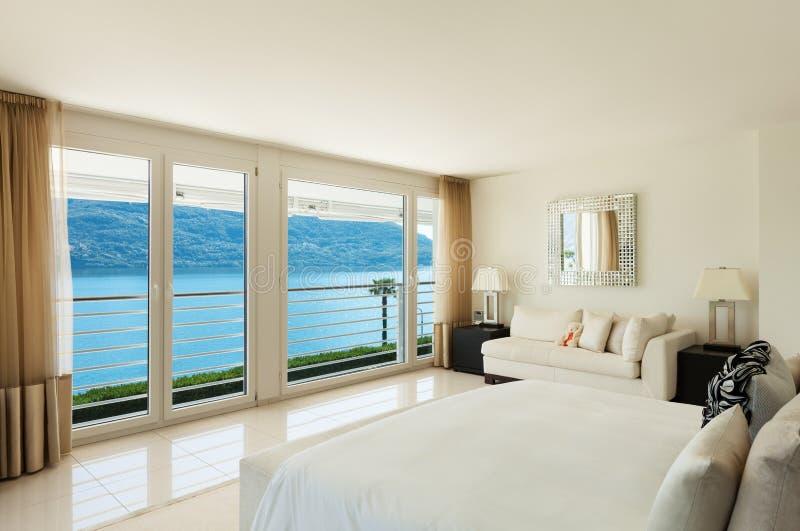 Modern binnenlands ontwerp, slaapkamer royalty-vrije stock afbeeldingen