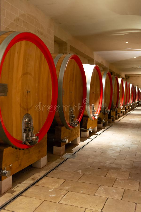 Modern bio wine production factory in Italy, caves with french o. Modern bio wine production factory in Italy, inox steel tanks used for fermentation of wine stock photography