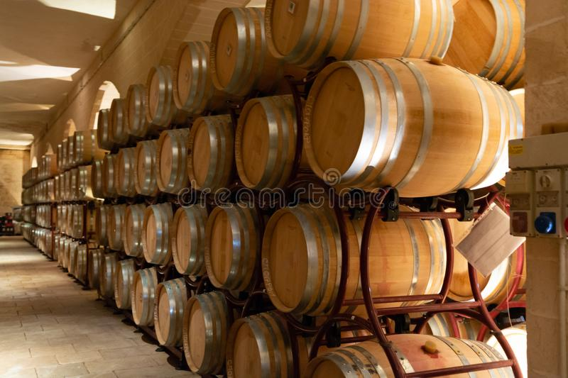 Modern bio wine production factory in Italy, caves with french o. Modern bio wine production factory in Italy, inox steel tanks used for fermentation of wine royalty free stock photo