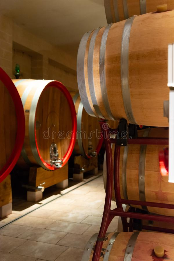 Modern bio wine production factory in Italy, caves with french o. Modern bio wine production factory in Italy, inox steel tanks used for fermentation of wine royalty free stock image
