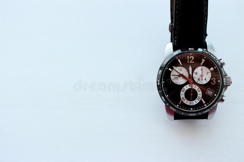 Modern black hand watch on wite background with copy space. Time and business background. Luxury men accessory. stock images