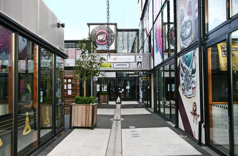 Contemporary outdoor retail project of Boxed Quarter in Christchurch, New Zealand. Modern black steel modular framing architecture with large glass windows and royalty free stock photography