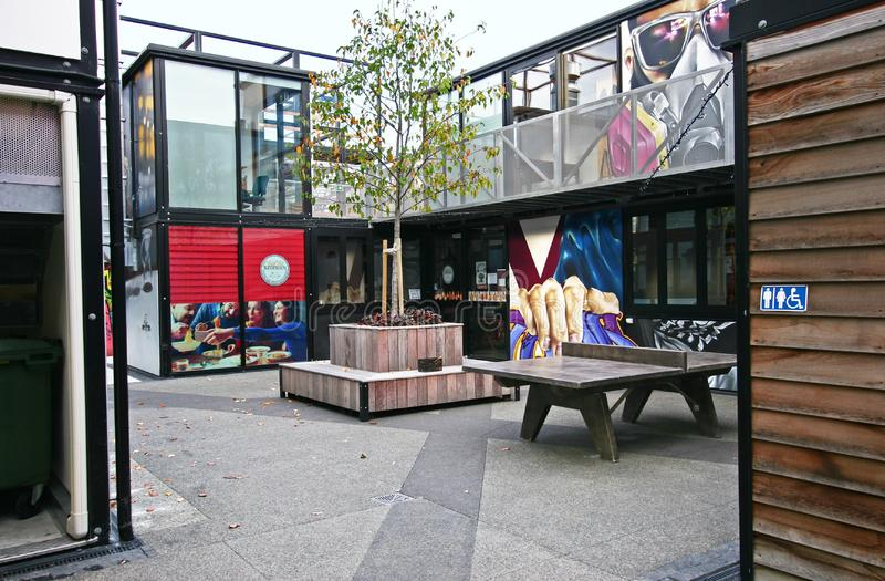 Contemporary outdoor retail project of Boxed Quarter in Christchurch, New Zealand. Modern black steel modular framing architecture with large glass windows stock images