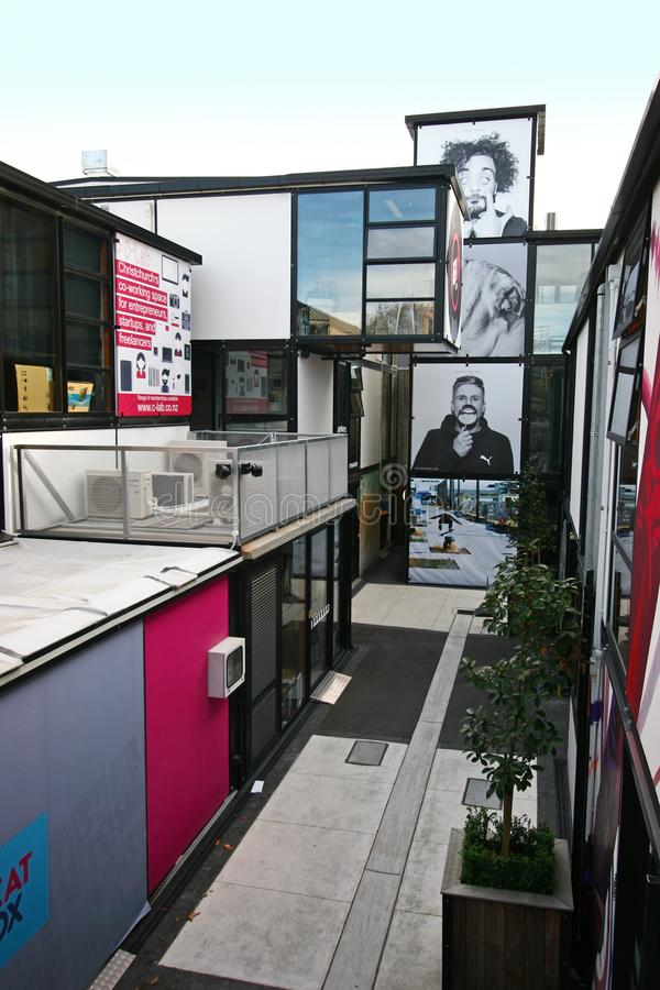 Contemporary outdoor retail project of Boxed Quarter in Christchurch, New Zealand. Modern black steel modular framing architecture with large glass windows and stock photos