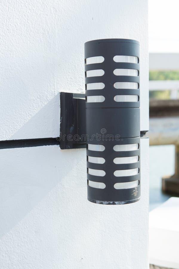 Modern black wall lamp stock photography