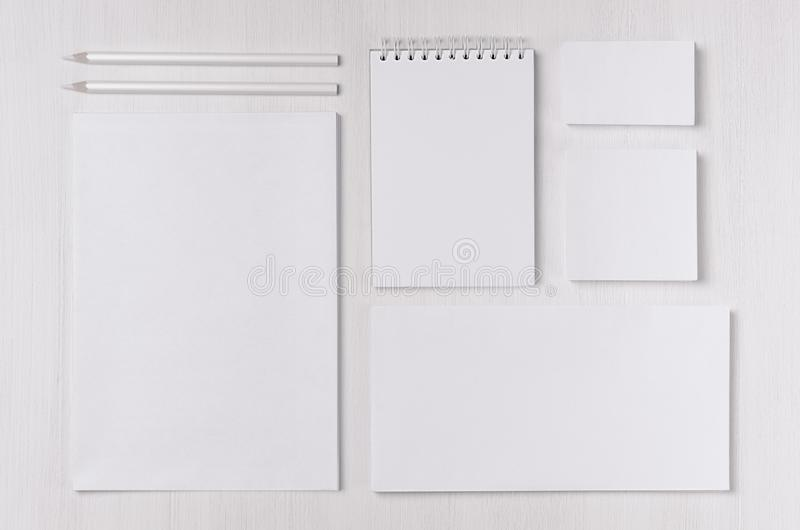 Modern blank white business stationery set with card, label, paper, notepad on soft light white wood table. Modern blank white business stationery set with card stock photos