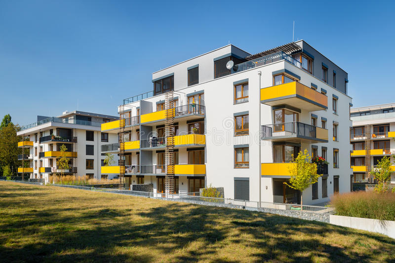 Modern block of flats with yellow balconies stock photography