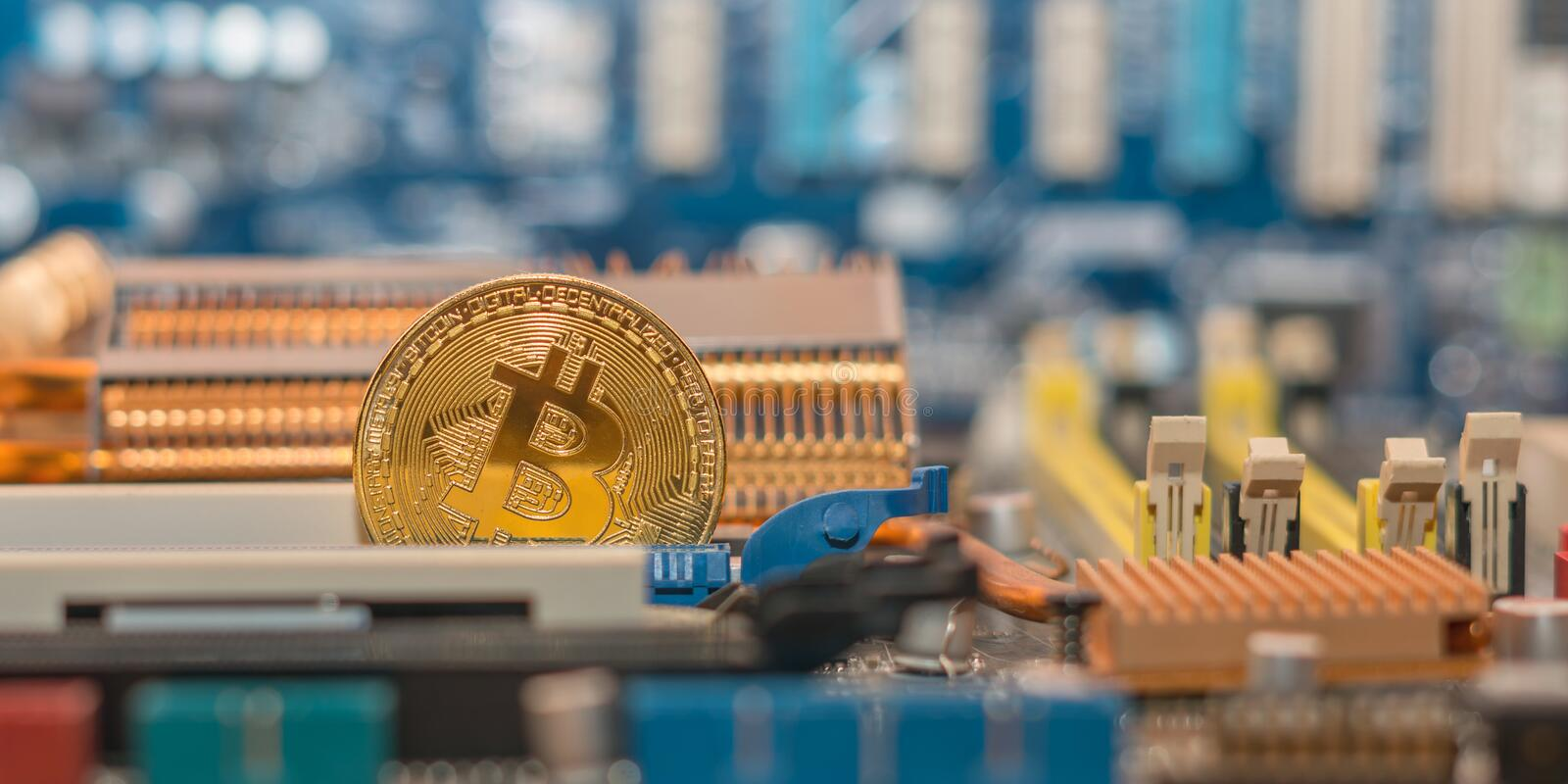 Modern blockchain technology, bitcoin coin on the computer motherboard. Modern blockchain technology, btc coin on the computer motherboard. Bitcoin and other stock image