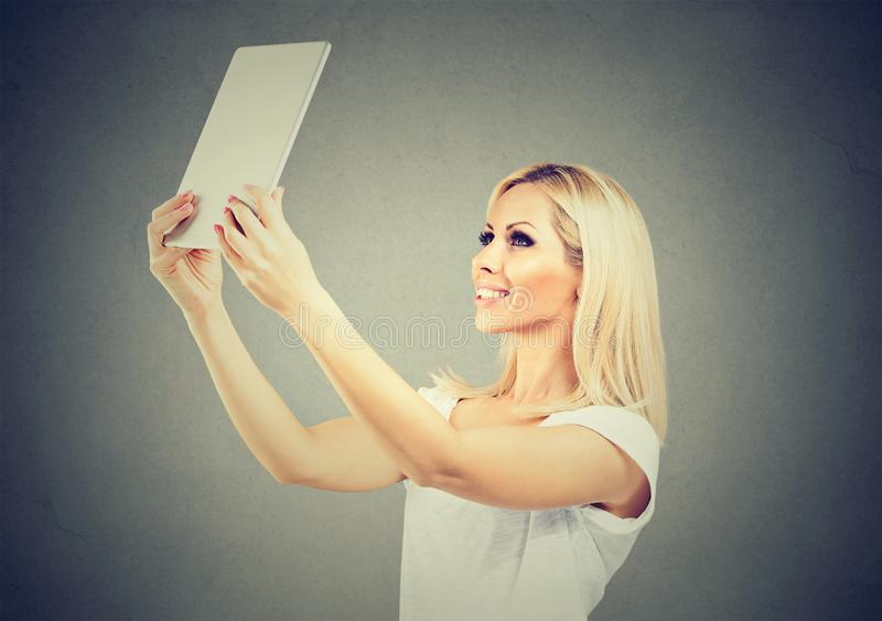 Stylish woman taking selfie with tablet stock images