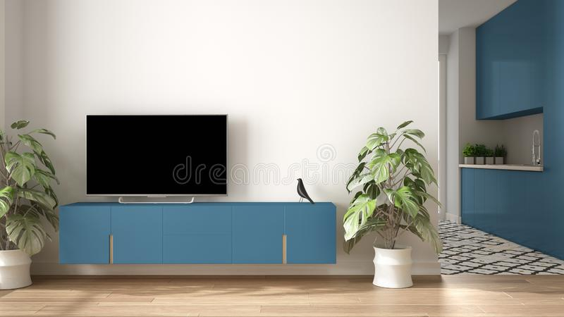Modern blue colored minimalist living room with small kitchen, parquet floor, tv cabinet, potted plant. Scandinavian colored tiles. And decors, architecture stock photo