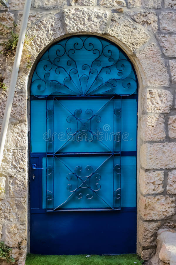 Modern Blue glass door with openwork a beautiful vintage background royalty free stock photo