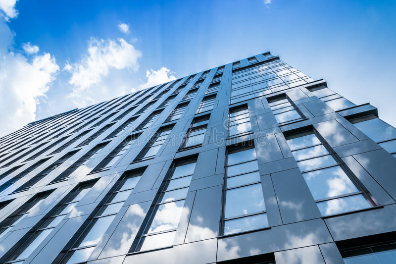 Modern blue glass wall of skyscraper. Business center royalty free stock photo