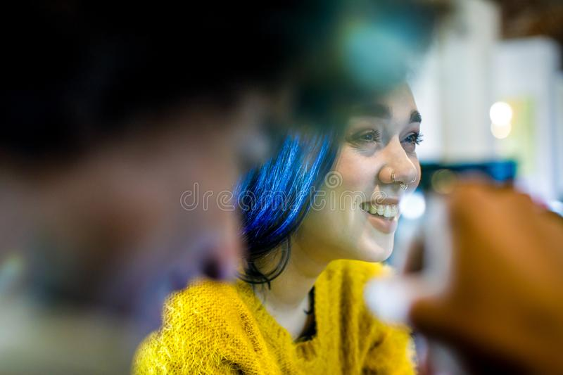 Modern blue hair woman smiling.Group of multiethnic people having business team meeting in restaurant lounge.Teamwork royalty free stock images