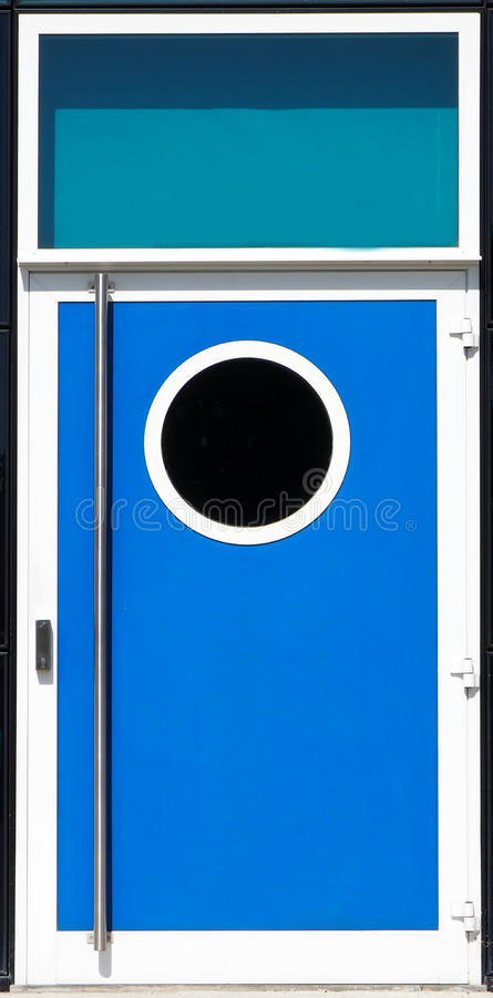 Modern blue metal door with a porthole window royalty free stock images
