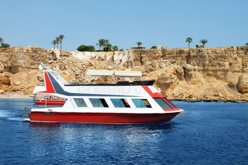 Modern boat near tropical resort on sunny day royalty free stock images