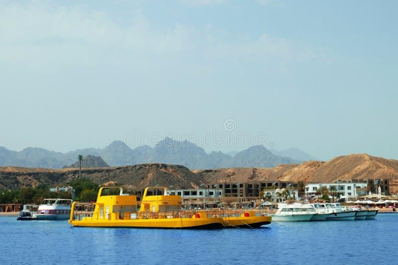 Modern boats near tropical resort on sunny day royalty free stock photo