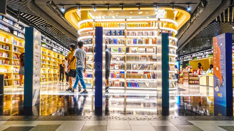 Bookstore book shop libraire book store. Modern bookstore in China Books and bookshelf in book shop Readers in bookshop royalty free stock photo