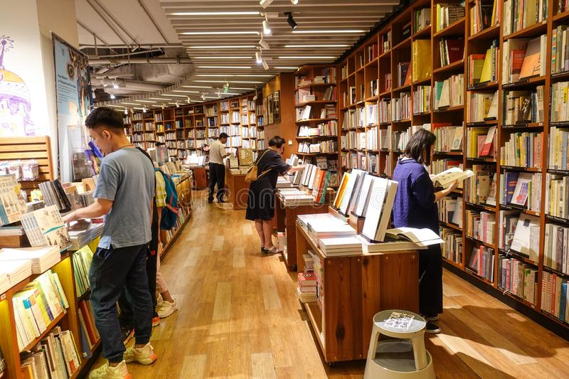 Bookstore book shop libraire book store. Modern bookstore in China Books and bookshelf in book shop Readers in bookshop royalty free stock images