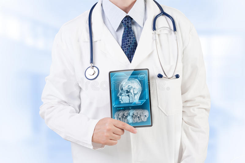 Modern brain research. Doctor with MRI scan on tablet screen stock photos