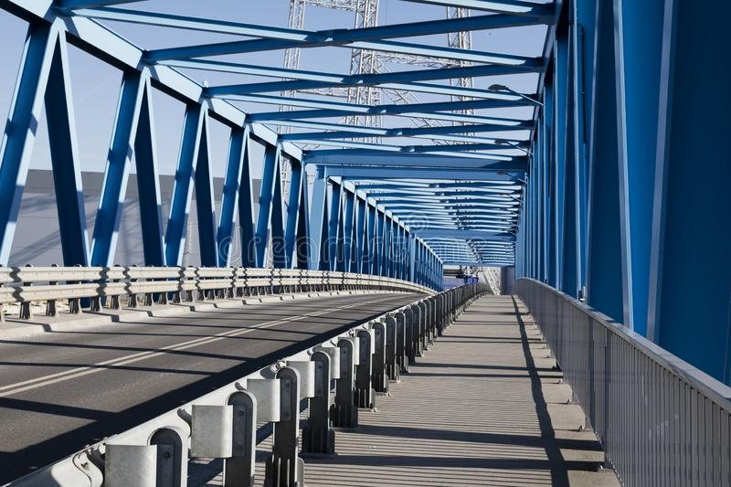 Modern bridge construction and road going through the bridge royalty free stock images