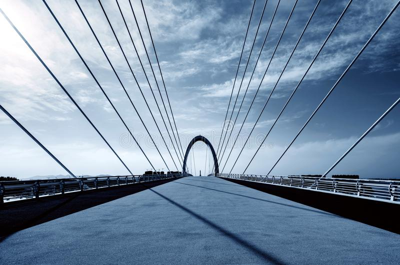 Modern bridge located in Nanjing, China. Modern bridges and skyscrapers in Nanjing, China royalty free stock images