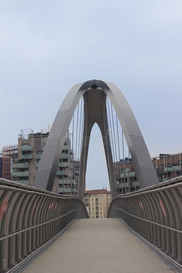 Modern bridge over the highway in Milan, Italy. Other buildings stock images