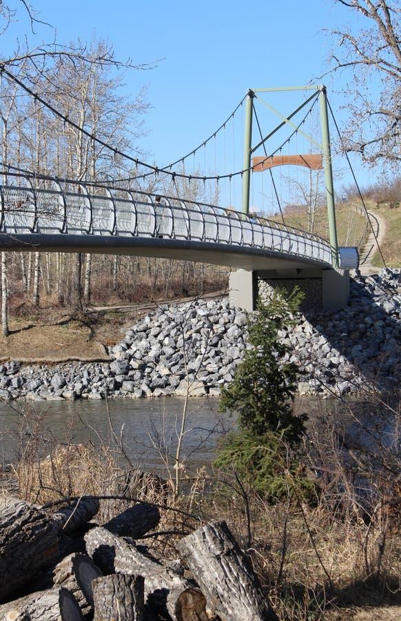 Modern bridge over the river in the Sandy Beach Park of Calgary, Alberta, Canada stock photography