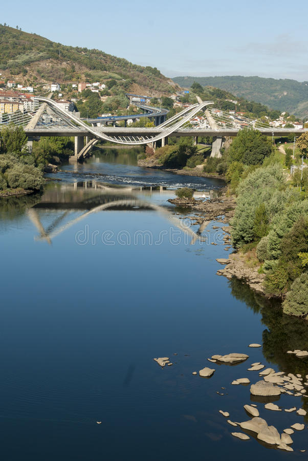Modern bridge and water reflection stock photography