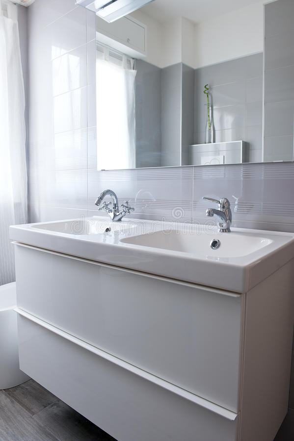 Modern Bright Clean Bathroom. Modern bathroom, double white ceramic sink royalty free stock images