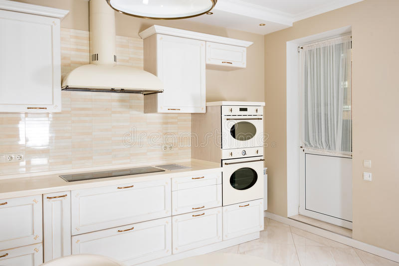 Modern, bright, clean kitchen interior in a luxury house. Interior design with classic or vintage elements. Practical. And well-furnished kitchen stock photo
