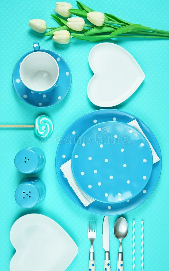 Colorful blue theme breakfast brunch table setting flatlay. Modern bright colorful blue theme morning breakfast or brunch table setting, flat lay royalty free stock photo