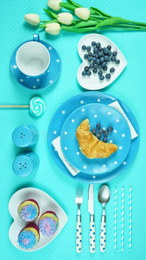 Colorful blue theme breakfast brunch table setting flatlay. Modern bright colorful blue theme morning breakfast or brunch table setting, flat lay royalty free stock images