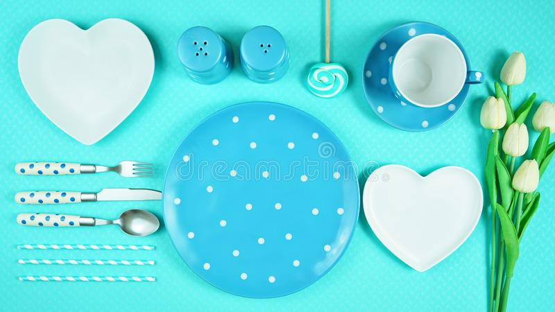 Colorful blue theme breakfast brunch table setting flatlay. Modern bright colorful blue theme morning breakfast or brunch table setting, flat lay stock photo