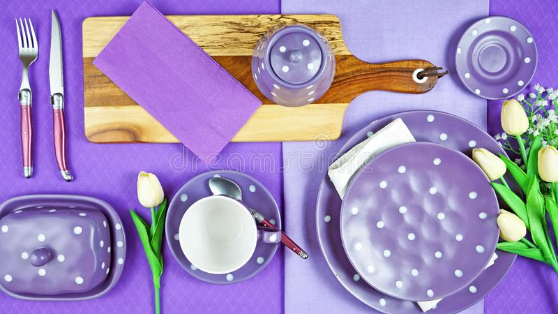 Colorful purple theme breakfast brunch table setting flatlay. stock image