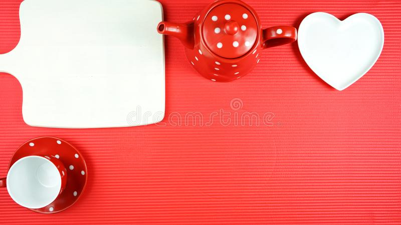 Colorful red theme breakfast brunch table setting flatlay with copy space. Modern bright colorful red theme morning breakfast or brunch table setting, flat lay stock image
