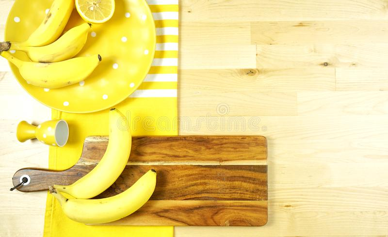 Colorful yellow theme breakfast brunch table setting flatlay. Modern bright colorful yellow theme morning breakfast or brunch table setting, flat lay with copy royalty free stock photography