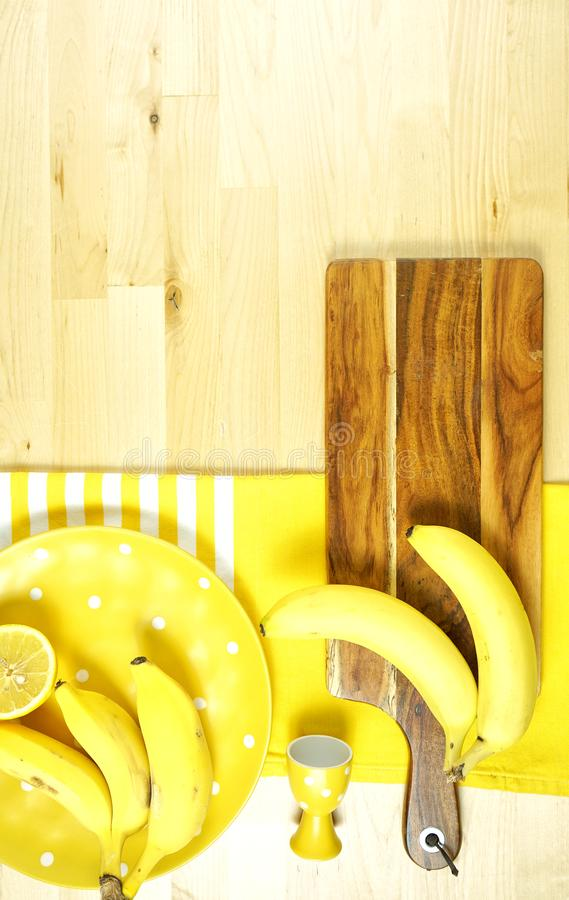 Colorful yellow theme breakfast brunch table setting flatlay. Modern bright colorful yellow theme morning breakfast or brunch table setting, flat lay with copy stock photography
