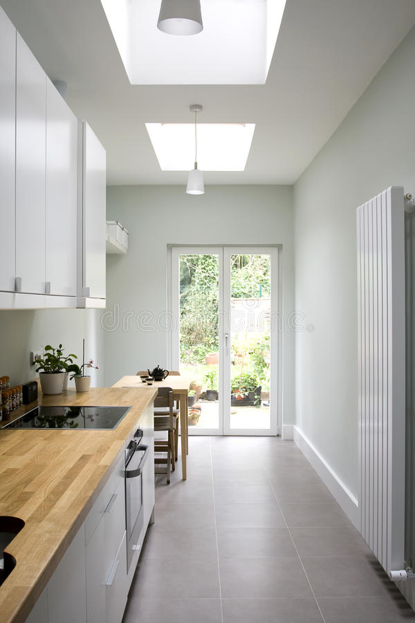 Modern bright kitchen, galley style royalty free stock photography