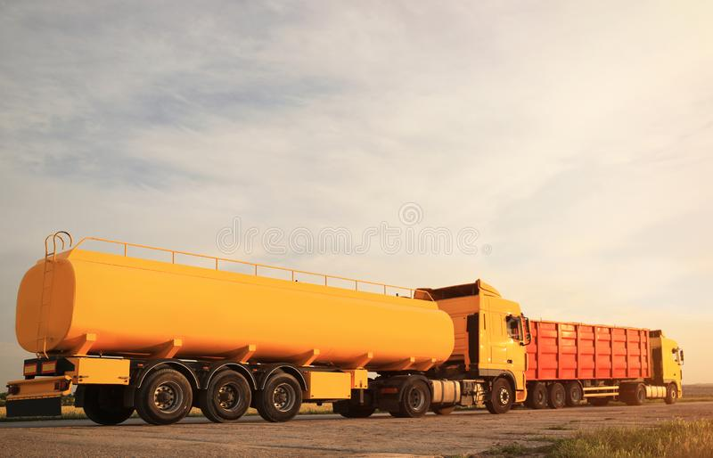 Modern bright trucks parked on road. Modern bright trucks parked on country road stock photo