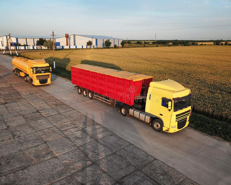Modern bright trucks parked. On country road royalty free stock photo