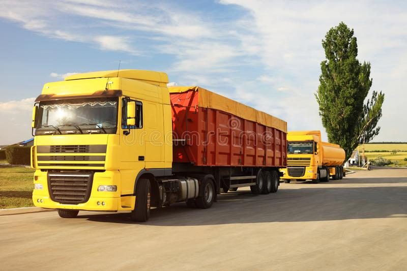 Modern bright trucks parked on country. Road royalty free stock photo