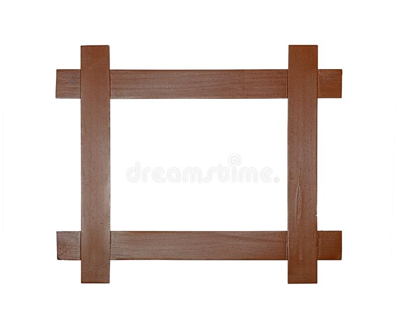 Modern brown wooden picture or photo frame. Simple minimalistic modern wooden frame for picture or photo made of crossed brown painted wood planks, isolated on royalty free stock photography