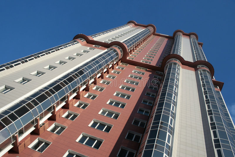 Modern building 4. The bottom view on a modern building against the blue sky royalty free stock photography