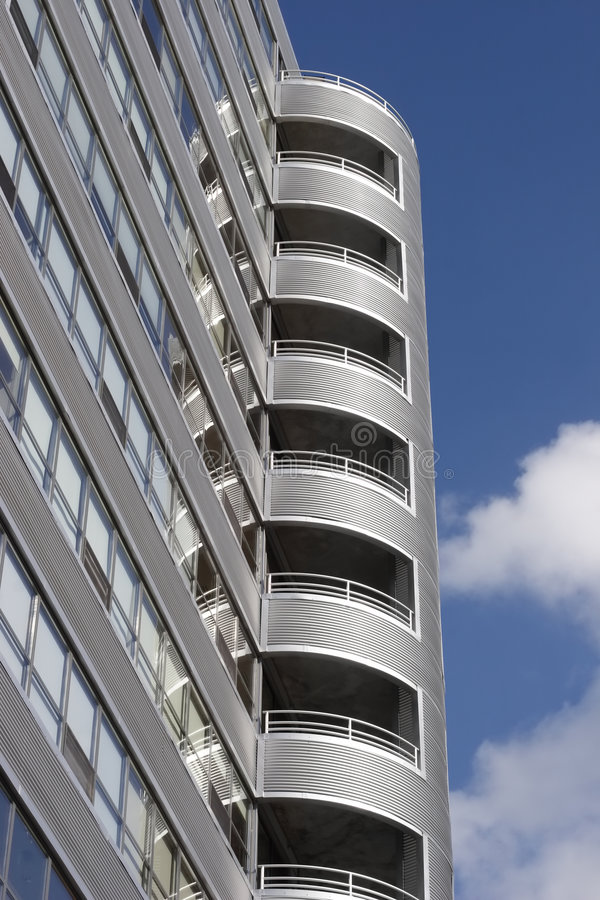 Modern building. Modern silver and glass building designed with a metal corregated facade stock photo