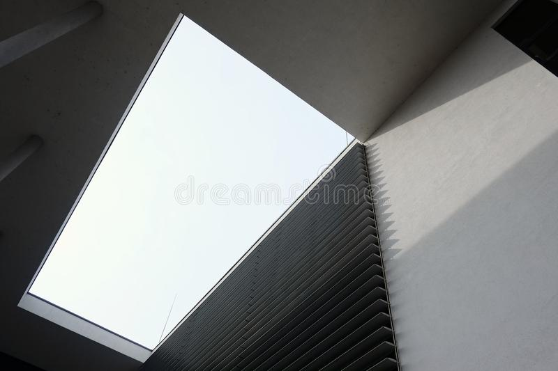 Modern building architecture with geometric shapes. Modern building architecture with geometric shapes mostly in grey colors. Futuristic design concept royalty free stock photos