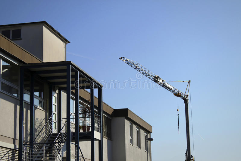 Modern building and crane royalty free stock images