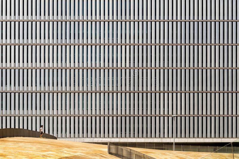 Modern building with a creative twist on the vertically shaped windows creating a fake illusion. A modern building with a creative twist on the vertically shaped stock photos