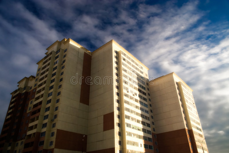 Modern building on dark sky background royalty free stock photography
