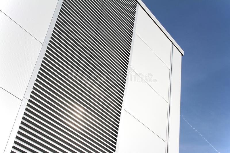 Modern building detail with metal grill. Against blue sky wief up royalty free stock photos