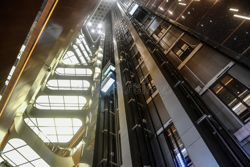 Modern building elevator well. Lit up by led light royalty free stock photo